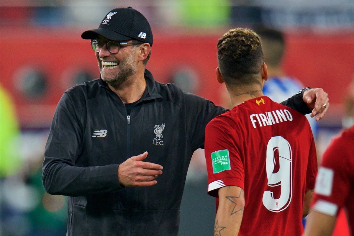 DOHA, QATAR - Wednesday, December 18, 2019: Liverpool's manager Jürgen Klopp (R) celebrates with match-winning goal-scorer Roberto Firmino after the FIFA Club World Cup Qatar 2019 Semi-Final match between CF Monterrey and Liverpool FC at the Khalifa Stadium. Liverpool won 2-1. (Pic by Peter Powell/Propaganda)