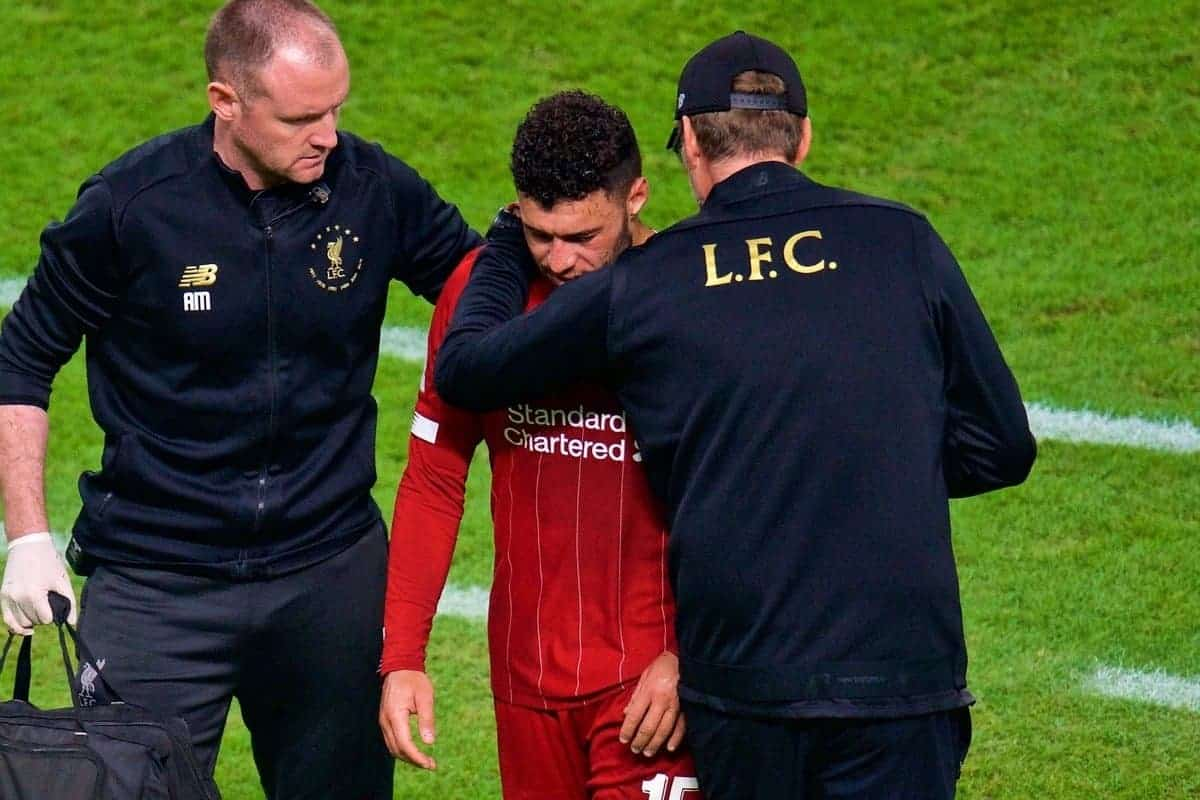 DOHA, QATAR - Saturday, December 21, 2019: Liverpool's Alex Oxlade-Chamberlain is treated during the FIFA Club World Cup Qatar 2019 Final match between CR Flamengo and Liverpool FC at the Khalifa Stadium. (Pic by Peter Powell/Propaganda)