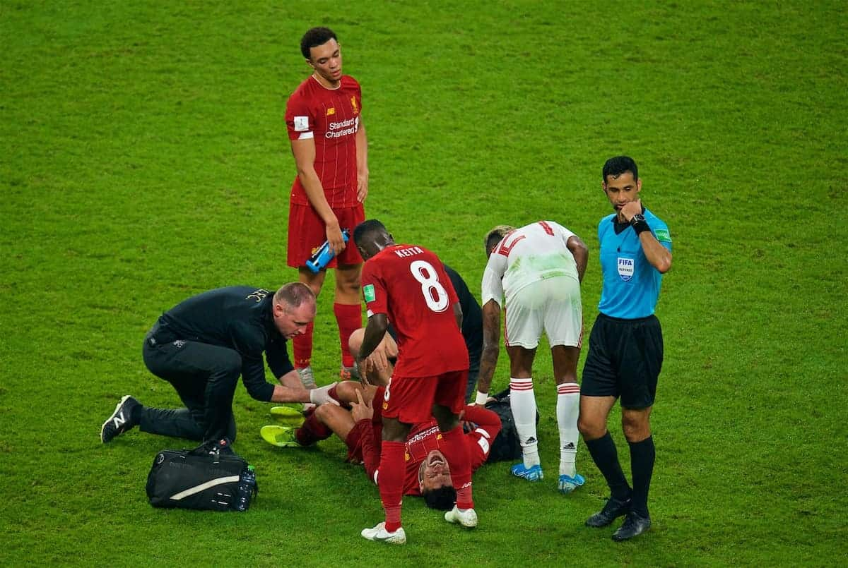 DOHA, QATAR - Saturday, December 21, 2019: Liverpool's Alex Oxlade-Chamberlain is injured during the FIFA Club World Cup Qatar 2019 Final match between CR Flamengo and Liverpool FC at the Khalifa Stadium. (Pic by Peter Powell/Propaganda)
