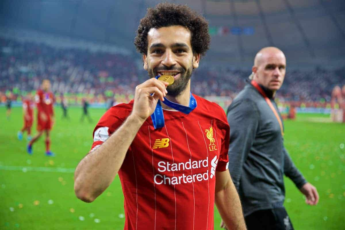 DOHA, QATAR - Saturday, December 21, 2019: Liverpool's Mohamed Salah bites his winners' medal after the FIFA Club World Cup Qatar 2019 Final match between CR Flamengo and Liverpool FC at the Khalifa Stadium. Liverpool won 1-0 after extra time. (Pic by David Rawcliffe/Propaganda)
