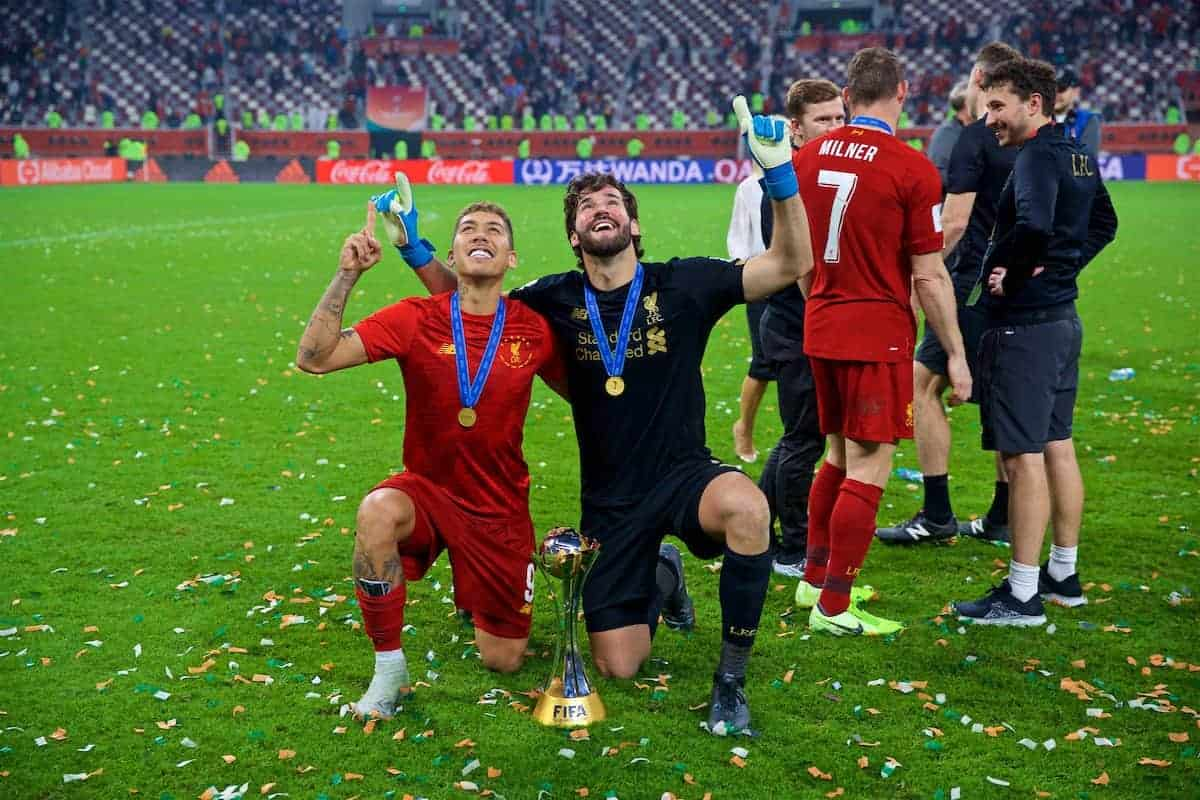 DOHA, QATAR - Saturday, December 21, 2019: Liverpool's Roberto Firmino (L) and goalkeeper Alisson Becker after the FIFA Club World Cup Qatar 2019 Final match between CR Flamengo and Liverpool FC at the Khalifa Stadium. Liverpool won 1-0 after extra time. (Pic by David Rawcliffe/Propaganda)