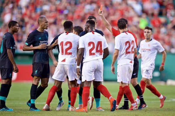 Sevilla FC's Joris Gnagnon (#24) is shown a red card and sent off during a friendly between Liverpool FC and Sevilla FC at Fenway Park on day six of the club's pre-season tour of America. (Pic by David Rawcliffe/Propaganda)