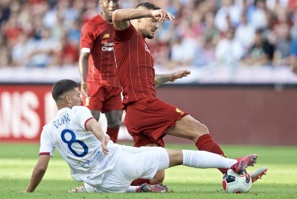 GENEVA, SWITZERLAND - Wednesday, July 31, 2019: Liverpool's Dejan Lovren tackles Olympique Lyonnais' Houssem Aouar during a pre-season friendly match between Liverpool FC and Olympique Lyonnais at Stade de Genève. (Pic by David Rawcliffe/Propaganda)