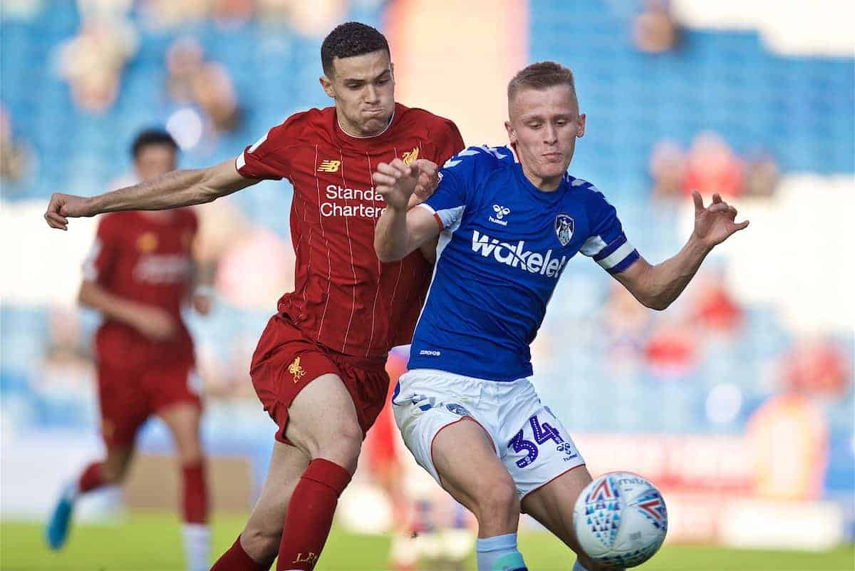 OLDHAM, ENGLAND - Wednesday, August 7, 2019: Liverpool's Issac Christie-Davies (L) challenges Oldham Athletic's Mohamad Sylla during the English Football League Trophy Northern Group B match between Oldham Athletic AFC and Liverpool FC at Boundary Park. (Pic by David Rawcliffe/Propaganda)