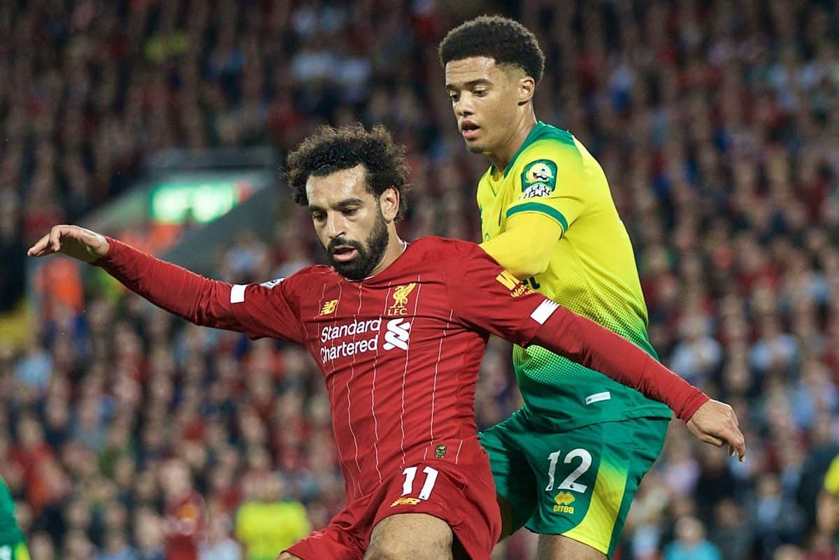 LIVERPOOL, ENGLAND - Friday, August 9, 2019: Liverpool's Mohamed Salah (L) and Norwich City's Jamal Lewis during the opening FA Premier League match of the season between Liverpool FC and Norwich City FC at Anfield. (Pic by David Rawcliffe/Propaganda)