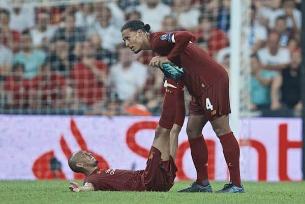 ISTANBUL, TURKEY - Wednesday, August 14, 2019: Liverpool's Fabio Henrique Tavares 'Fabinho' is treated for cramp by team-mate Virgil van Dijk at the final whistle during the UEFA Super Cup match between Liverpool FC and Chelsea FC at Besiktas Park. (Pic by David Rawcliffe/Propaganda)