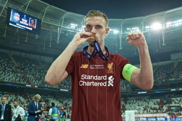 ISTANBUL, TURKEY - Wednesday, August 14, 2019: Liverpool's captain Jordan Henderson bites his winners' medal as he celebrates after beating Chelsea in the shoot-out to win the Super Cup during the UEFA Super Cup match between Liverpool FC and Chelsea FC at Besiktas Park. Liverpool won 5-4 on penalties after a 1-1 draw. (Pic by David Rawcliffe/Propaganda)