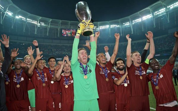 ISTANBUL, TURKEY - Wednesday, August 14, 2019: Liverpool's goalkeeper Adrián San Miguel del Castillo celebrates with the trophy after his save in the shoot-out won the Super Cup after the UEFA Super Cup match between Liverpool FC and Chelsea FC at Besiktas Park. Liverpool won 5-4 on penalties after a 1-1 draw. (Pic by David Rawcliffe/Propaganda)