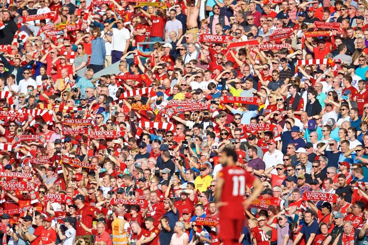 "LIVERPOOL, ENGLAND - Saturday, August 24, 2019: Liverpool supporters sing ""You'll Never Walk Alone"" before the FA Premier League match between Liverpool FC and Arsenal FC at Anfield. (Pic by David Rawcliffe/Propaganda)"