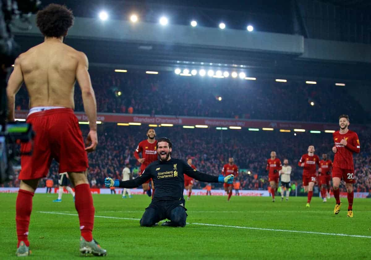 LIVERPOOL, ENGLAND - Sunday, January 19, 2020: Liverpool's Mohamed Salah celebrates scoring the second goal with team-mate goalkeeper Alisson Becker during the FA Premier League match between Liverpool FC and Manchester United FC at Anfield. (Pic by David Rawcliffe/Propaganda)