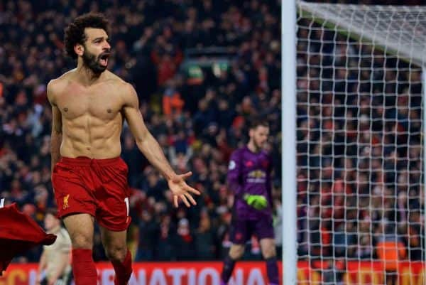 LIVERPOOL, ENGLAND - Sunday, January 19, 2020: Liverpool's Mohamed Salah takes off his shirt as he celebrate scoring the second goal during the FA Premier League match between Liverpool FC and Manchester United FC at Anfield. (Pic by David Rawcliffe/Propaganda)