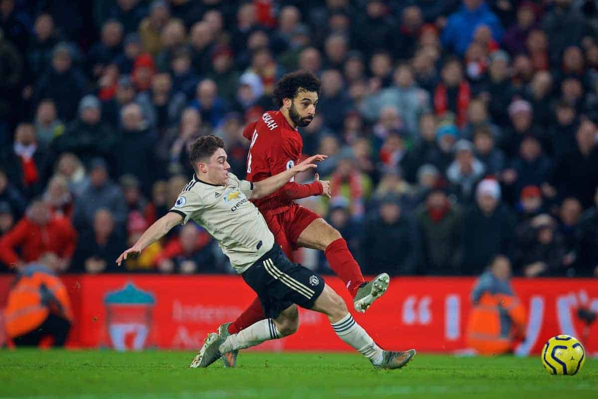 LIVERPOOL, ENGLAND - Sunday, January 19, 2020: Liverpool's Mohamed Salah takes off his shirt as he celebrates scoring the second goal during the FA Premier League match between Liverpool FC and Manchester United FC at Anfield. (Pic by David Rawcliffe/Propaganda)
