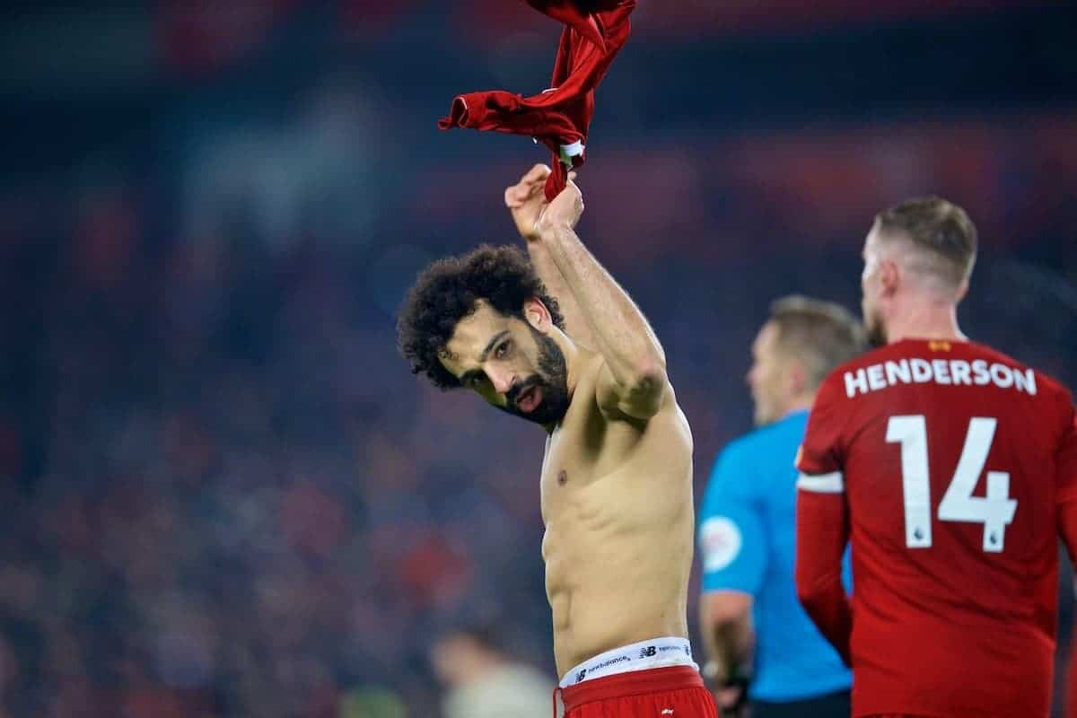LIVERPOOL, ENGLAND - Sunday, January 19, 2020: Liverpool's Mohamed Salah takes off his shirt as he celebrates scoring the second goal during the FA Premier League match between Liverpool FC and Manchester United FC at Anfield. Liverpool won 2-0. (Pic by David Rawcliffe/Propaganda)