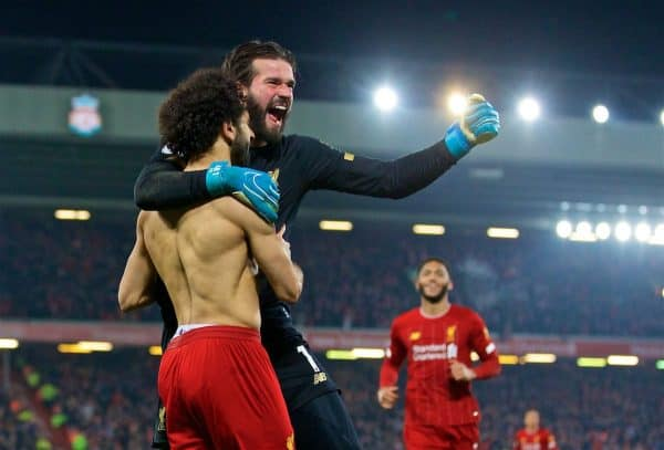 LIVERPOOL, ENGLAND - Sunday, January 19, 2020: Liverpool's Mohamed Salah (L) celebrates scoring the second goal with team-mate goalkeeper Alisson Becker during the FA Premier League match between Liverpool FC and Manchester United FC at Anfield. (Pic by David Rawcliffe/Propaganda)