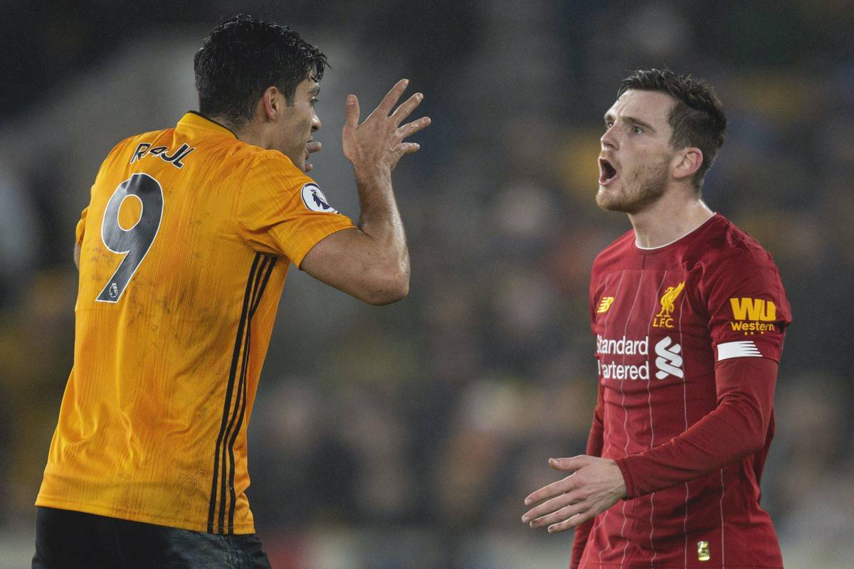Wolverhampton Wanderers' Raúl Jiménez (L) and Liverpool's Andy Robertson during the FA Premier League match between Wolverhampton Wanderers FC and Liverpool FC at Molineux Stadium. (Pic by David Rawcliffe/Propaganda)