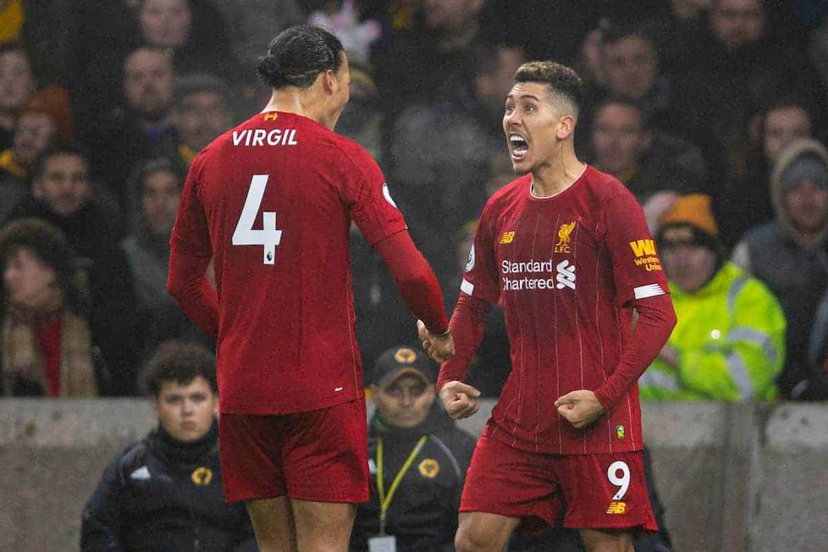 Liverpool's Roberto Firmino (R) celebrates scoring the second goal with team-mate Virgil van Dijk during the FA Premier League match between Wolverhampton Wanderers FC and Liverpool FC at Molineux Stadium. (Pic by David Rawcliffe/Propaganda)