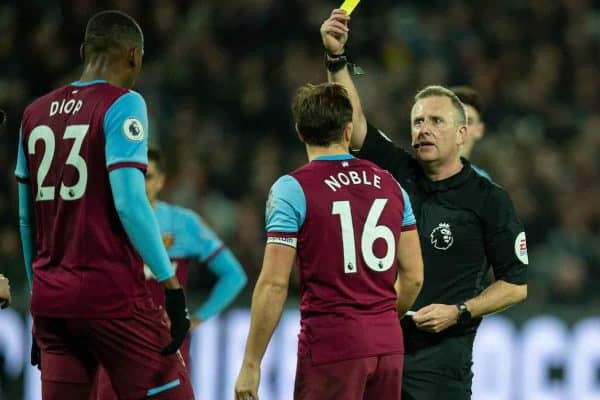 LONDON, ENGLAND - Wednesday, January 29, 2020: West Ham United's Issa Diop is shown a yellow card by referee Jonathan Moss during the FA Premier League match between West Ham United FC and Liverpool FC at the London Stadium. (Pic by David Rawcliffe/Propaganda)
