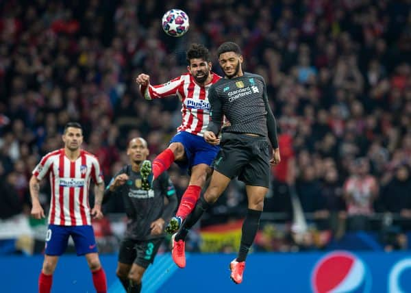 MADRID, SPAIN - Tuesday, February 18, 2020: Liverpool's Joe Gomez (R) challenges for a header with Club Atlético de Madrid's Diego Costa during the UEFA Champions League Round of 16 1st Leg match between Club Atlético de Madrid and Liverpool FC at the Estadio Metropolitano. (Pic by David Rawcliffe/Propaganda)