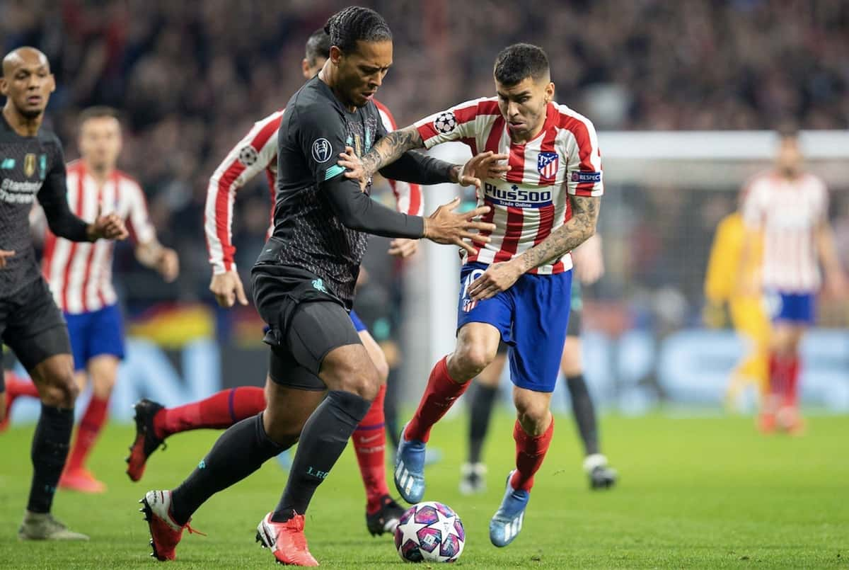 MADRID, SPAIN - Tuesday, February 18, 2020: Liverpool's Virgil van Dijk (L) and Club Atlético de Madrid's A?ngel Correa during the UEFA Champions League Round of 16 1st Leg match between Club Atlético de Madrid and Liverpool FC at the Estadio Metropolitano. (Pic by David Rawcliffe/Propaganda)