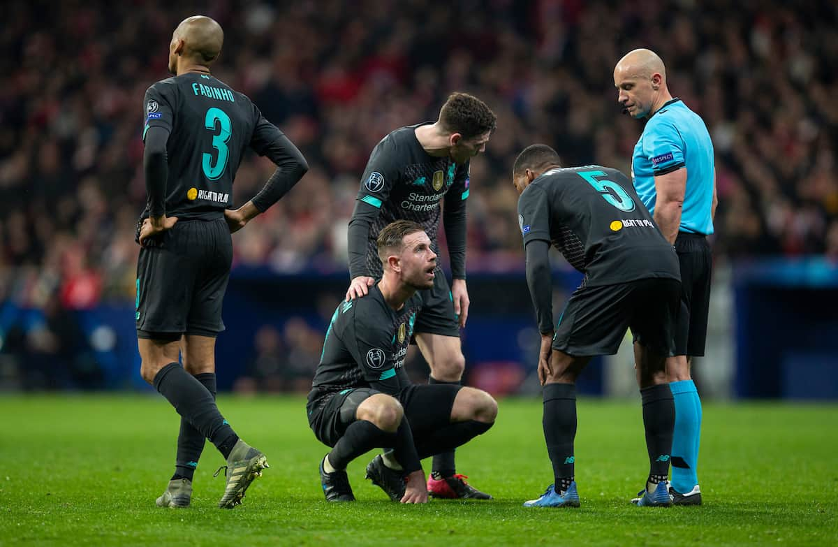 MADRID, SPAIN - Tuesday, February 18, 2020: Liverpool's captain Jordan Henderson goes down injured during the UEFA Champions League Round of 16 1st Leg match between Club Atlético de Madrid and Liverpool FC at the Estadio Metropolitano. (Pic by David Rawcliffe/Propaganda)