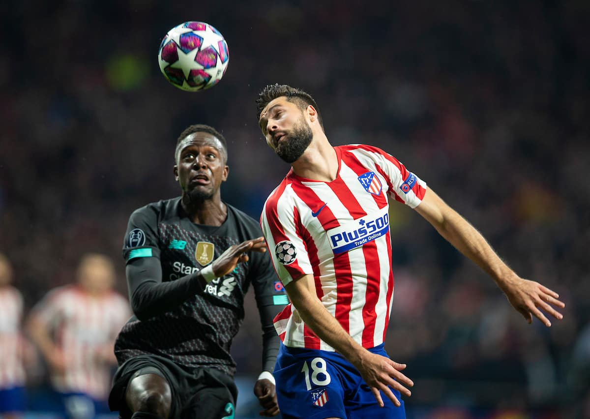 MADRID, SPAIN - Tuesday, February 18, 2020: Liverpool's Divock Origi (L) and Club Atlético de Madrid's Felipe Augusto de Almeida Monteiro during the UEFA Champions League Round of 16 1st Leg match between Club Atlético de Madrid and Liverpool FC at the Estadio Metropolitano. (Pic by David Rawcliffe/Propaganda)