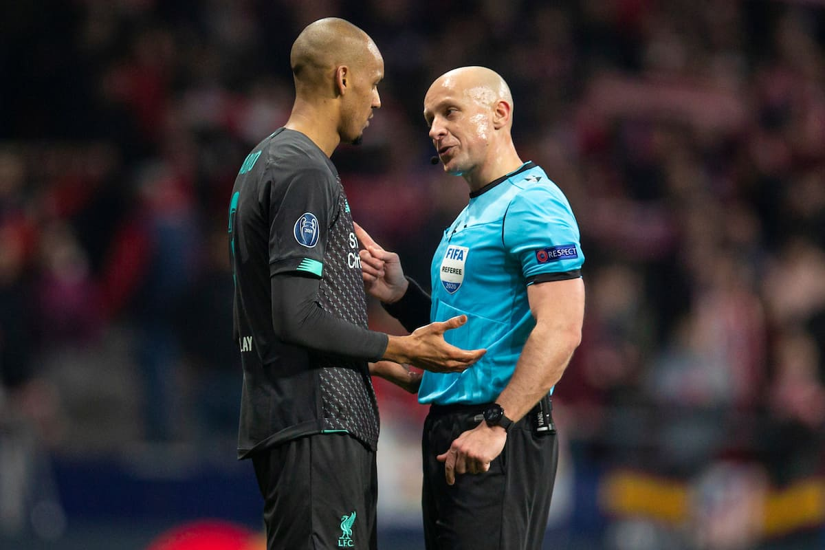 MADRID, SPAIN - Tuesday, February 18, 2020: Liverpool's Fabio Henrique Tavares 'Fabinho' is spoken to by referee Szymon Marciniak during the UEFA Champions League Round of 16 1st Leg match between Club Atlético de Madrid and Liverpool FC at the Estadio Metropolitano. (Pic by David Rawcliffe/Propaganda)