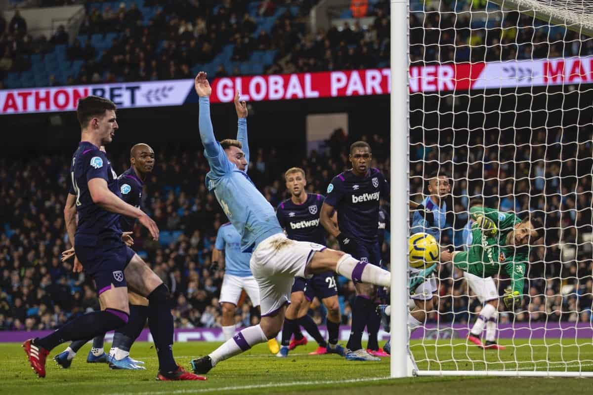 MANCHESTER, ENGLAND - Wednesday, February 19, 2020: Manchester City's Aymeric Laporte follows the ball into the net as Rodrigo Hernández Cascante 'Rodri' scores the opening goal during the FA Premier League match between Manchester City FC and West Ham United FC at the City of Manchester Stadium. (Pic by David Rawcliffe/Propaganda)