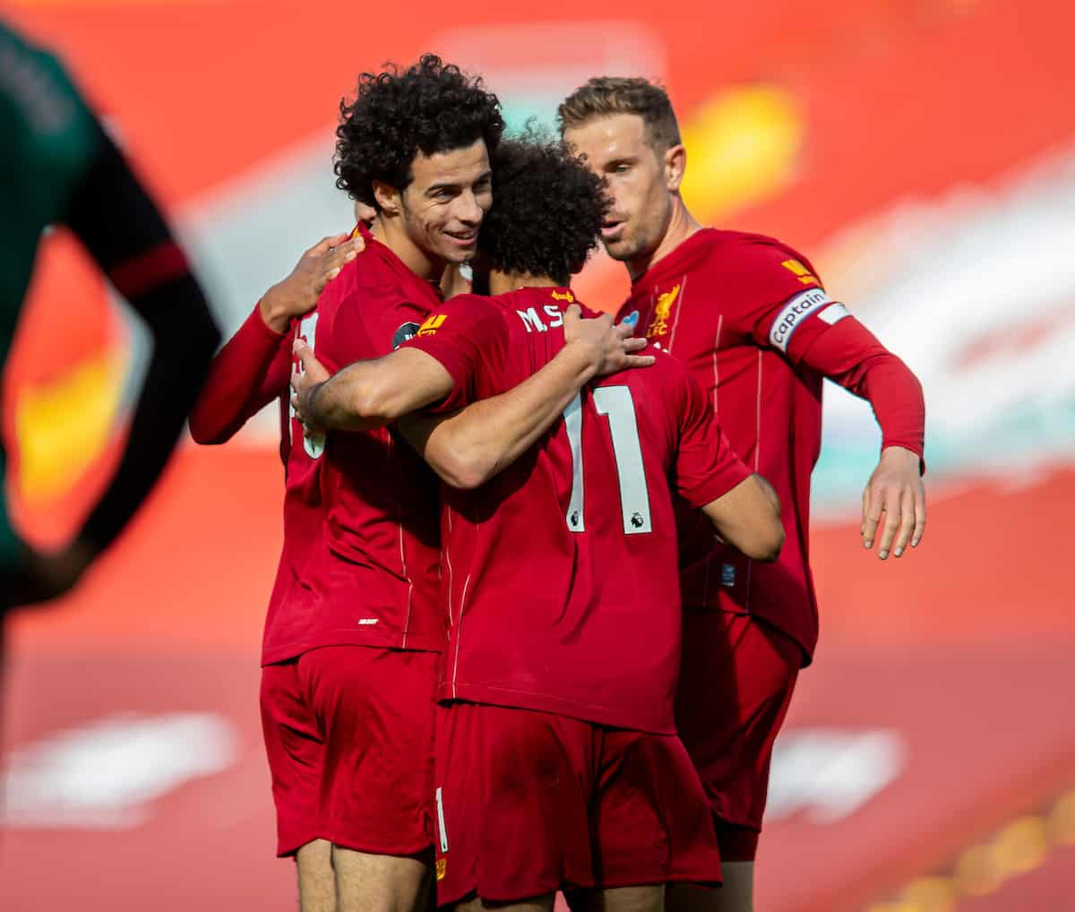 LIVERPOOL, ENGLAND - Sunday, July 5, 2020: Liverpool's Curtis Jones (L) celebrates scoring the second goal with team-mates during the FA Premier League match between Liverpool FC and Aston Villa FC at Anfield. The game was played behind closed doors due to the UK government's social distancing laws during the Coronavirus COVID-19 Pandemic. (Pic by David Rawcliffe/Propaganda)