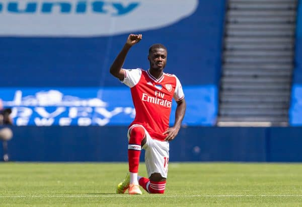 BRIGHTON & HOVE, ENGLAND - Saturday, June 20, 2020: Arsenal's Nicolas Pépé kneels down in support of the Black Lives Matter campaign during the FA Premier League match between Brighton & Hove Albion FC and Arsenal FC at the AMEX Stadium. (Pic by David Rawcliffe/Propaganda)