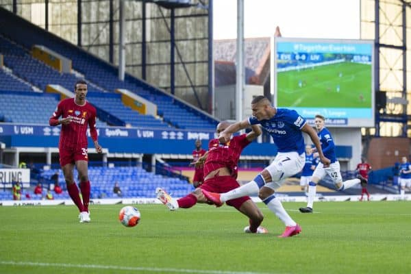 LIVERPOOL, ENGLAND - Sunday, June 21, 2019: Everton's Richarlison de Andrade shoots under pressure from Liverpool's Fabio Henrique Tavares 'Fabinho' during the FA Premier League match between Everton FC and Liverpool FC, the 236th Merseyside Derby, at Goodison Park. The game was played behind closed doors due to the UK government's social distancing laws during the Coronavirus COVID-19 Pandemic. (Pic by David Rawcliffe/Propaganda)