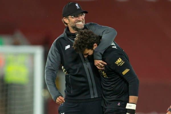 LIVERPOOL, ENGLAND - Wednesday, June 24, 2020: Liverpool's manager Jürgen Klopp embraces goalkeeper Alisson Becker after the FA Premier League match between Liverpool FC and Crystal Palace FC at Anfield. The game was played behind closed doors due to the UK government's social distancing laws during the Coronavirus COVID-19 Pandemic. Liverpool won 4-0. (Pic by David Rawcliffe/Propaganda)