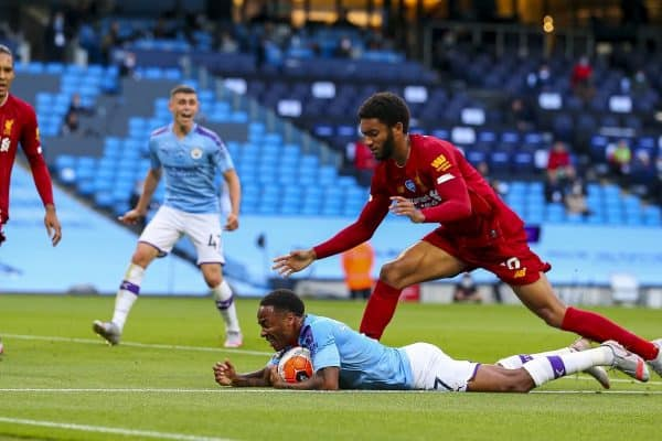 MANCHESTER, ENGLAND - Thursday, July 2, 2020: Manchester City's Raheem Sterling goes down in the area under pressure from Liverpool's Joe Gomez to win a penalty during the FA Premier League match between Manchester City FC and Liverpool FC at the City of Manchester Stadium. The game was played behind closed doors due to the UK government's social distancing laws during the Coronavirus COVID-19 Pandemic. This was Liverpool's first game as Premier League 2019/20 Champions. (Pic by Propaganda)