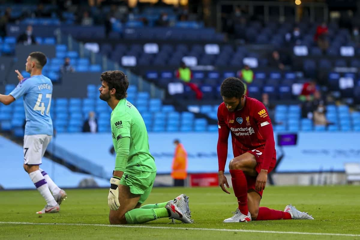 MANCHESTER, ENGLAND - Thursday, July 2, 2020: Liverpool's goalkeeper Alisson Becker (L) and Joe Gomez looks dejected as Manchester City score the second goal during the FA Premier League match between Manchester City FC and Liverpool FC at the City of Manchester Stadium. The game was played behind closed doors due to the UK government's social distancing laws during the Coronavirus COVID-19 Pandemic. This was Liverpool's first game as Premier League 2019/20 Champions. (Pic by Propaganda)