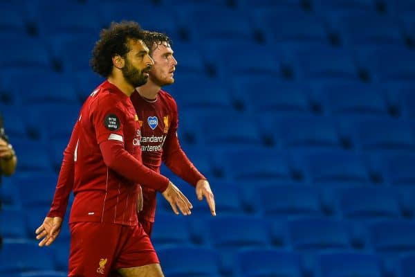 BRIGHTON & HOVE, ENGLAND - Wednesday, July 8, 2020: Liverpool's Mohamed Salah (L) celebrates scoring the third goal, his second of the game, with team-mate Andy Robertson (R) during the FA Premier League match between Brighton & Hove Albion FC and Liverpool FC at the AMEX Stadium. The game was played behind closed doors due to the UK government's social distancing laws during the Coronavirus COVID-19 Pandemic. (Pic by Propaganda)