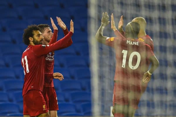 BRIGHTON & HOVE, ENGLAND - Wednesday, July 8, 2020: Liverpool's Mohamed Salah (L) celebrates scoring the third goal, his second of the game, with team-mates during the FA Premier League match between Brighton & Hove Albion FC and Liverpool FC at the AMEX Stadium. The game was played behind closed doors due to the UK government's social distancing laws during the Coronavirus COVID-19 Pandemic. (Pic by Propaganda)