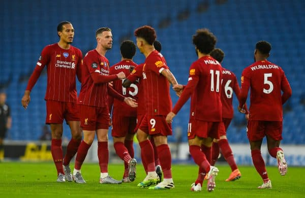 BRIGHTON & HOVE, ENGLAND - Wednesday, July 8, 2020: Liverpool's Virgil van Dijk, captain Jordan Henderson and Roberto Firmino celebrates with opening goal scorer Mohamed Salah during the FA Premier League match between Brighton & Hove Albion FC and Liverpool FC at the AMEX Stadium. The game was played behind closed doors due to the UK government's social distancing laws during the Coronavirus COVID-19 Pandemic. (Pic by Propaganda)