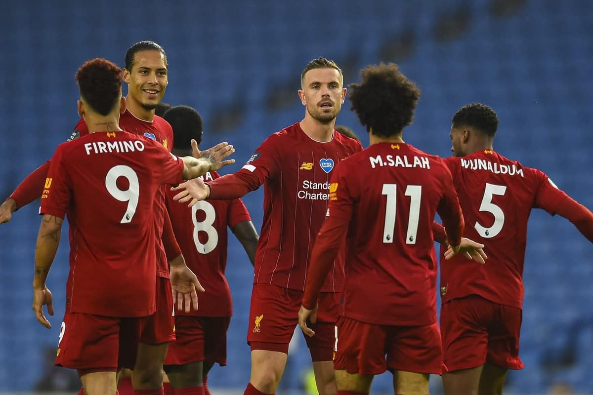 BRIGHTON & HOVE, ENGLAND - Wednesday, July 8, 2020: Liverpool's captain Jordan Henderson (C) celebrates with the opening goal scorer Mohamed Salah during the FA Premier League match between Brighton & Hove Albion FC and Liverpool FC at the AMEX Stadium. The game was played behind closed doors due to the UK government's social distancing laws during the Coronavirus COVID-19 Pandemic. (Pic by Propaganda)