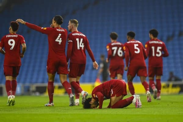 Liverpool's Mohamed Salah kneels to pray as he celebrates scoring the first goal during the FA Premier League match between Brighton & Hove Albion FC and Liverpool FC at the AMEX Stadium. The game was played behind closed doors due to the UK government's social distancing laws during the Coronavirus COVID-19 Pandemic. (Pic by Propaganda)