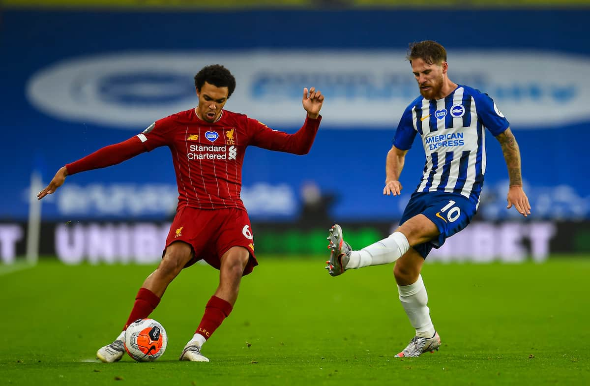 BRIGHTON & HOVE, ENGLAND - Wednesday, July 8, 2020: Liverpool's Trent Alexander-Arnold crosses the ball under pressure from Brighton & Hove Albion's Alexis Mac Allister during the FA Premier League match between Brighton & Hove Albion FC and Liverpool FC at the AMEX Stadium. The game was played behind closed doors due to the UK government's social distancing laws during the Coronavirus COVID-19 Pandemic. (Pic by Propaganda)