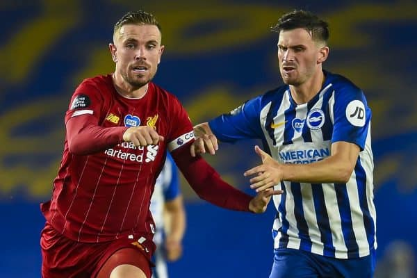 Liverpool's captain Jordan Henderson (L) and Brighton & Hove Albion's Pascal Gross during the FA Premier League match between Brighton & Hove Albion FC and Liverpool FC at the AMEX Stadium. The game was played behind closed doors due to the UK government's social distancing laws during the Coronavirus COVID-19 Pandemic. (Pic by Propaganda)