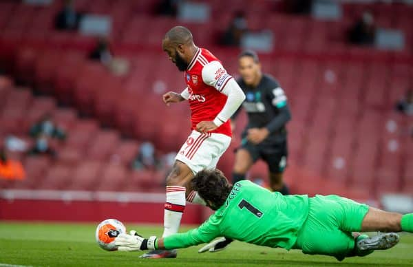 LONDON, ENGLAND - Tuesday, July 14, 2020: Arsenal's Alexandre Lacazette rounds Liverpool's goalkeeper Alisson Becker to score the first equalising goal during the FA Premier League match between Arsenal FC and Liverpool FC at the Emirates Stadium. The game was played behind closed doors due to the UK government's social distancing laws during the Coronavirus COVID-19 Pandemic. (Pic by David Rawcliffe/Propaganda)