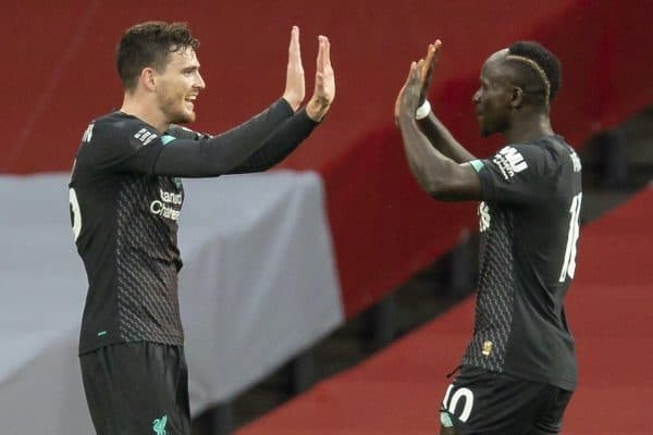 LONDON, ENGLAND - Tuesday, July 14, 2020: Liverpool's Sadio Mané (R) celebrates scoring the first goal with team-mate Andy Robertson during the FA Premier League match between Arsenal FC and Liverpool FC at the Emirates Stadium. The game was played behind closed doors due to the UK government's social distancing laws during the Coronavirus COVID-19 Pandemic. (Pic by David Rawcliffe/Propaganda)