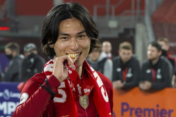 LIVERPOOL, ENGLAND - Wednesday, July 22, 2020: Liverpool's Japan international Takumi Minamino bites his winners' medal after being crowned Champions after the FA Premier League match between Liverpool FC and Chelsea FC at Anfield. The game was played behind closed doors due to the UK government's social distancing laws during the Coronavirus COVID-19 Pandemic. Liverpool won 5-3. (Pic by David Rawcliffe/Propaganda)
