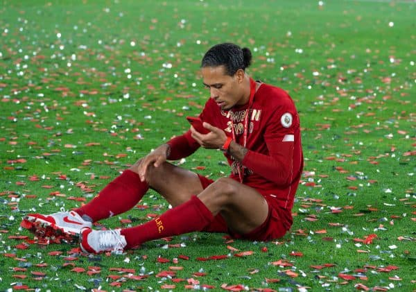 LIVERPOOL, ENGLAND - Wednesday, July 22, 2020: Liverpool's Virgil van Dijk finds a quiet moment to make a Face Time call after being crowned Champions after the FA Premier League match between Liverpool FC and Chelsea FC at Anfield. The game was played behind closed doors due to the UK government's social distancing laws during the Coronavirus COVID-19 Pandemic. Liverpool won 5-3. (Pic by David Rawcliffe/Propaganda)