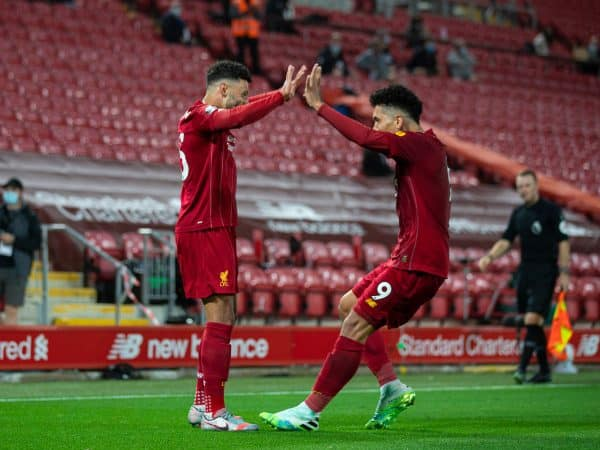 LIVERPOOL, ENGLAND - Wednesday, July 22, 2020: Liverpool's Alex Oxlade-Chamberlain celebrates scoring the fifth goal with team-mate Roberto Firmino during the FA Premier League match between Liverpool FC and Chelsea FC at Anfield. The game was played behind closed doors due to the UK government's social distancing laws during the Coronavirus COVID-19 Pandemic. (Pic by David Rawcliffe/Propaganda)