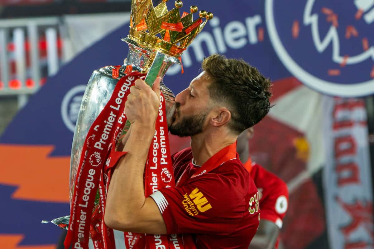 LIVERPOOL, ENGLAND - Wednesday, July 22, 2020: Liverpool's Adam Lallana kisses the trophy after the FA Premier League match between Liverpool FC and Chelsea FC at Anfield. The game was played behind closed doors due to the UK government's social distancing laws during the Coronavirus COVID-19 Pandemic. (Pic by David Rawcliffe/Propaganda)
