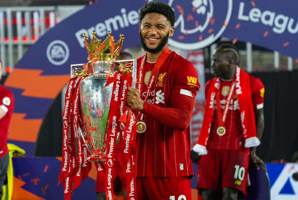 LIVERPOOL, ENGLAND - Wednesday, July 22, 2020: Liverpool's Joe Gomez the trophy after the FA Premier League match between Liverpool FC and Chelsea FC at Anfield. The game was played behind closed doors due to the UK government's social distancing laws during the Coronavirus COVID-19 Pandemic. (Pic by David Rawcliffe/Propaganda)