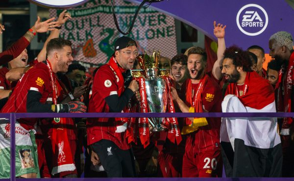 LIVERPOOL, ENGLAND - Wednesday, July 22, 2020: Liverpool's manager Jürgen Klopp (L) and Adam Lallana lift the Premier League trophy after the FA Premier League match between Liverpool FC and Chelsea FC at Anfield. The game was played behind closed doors due to the UK government's social distancing laws during the Coronavirus COVID-19 Pandemic. Liverpool won 5-3. (Pic by David Rawcliffe/Propaganda)