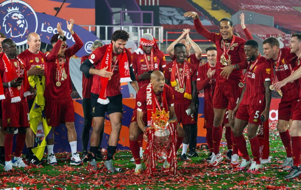 LIVERPOOL, ENGLAND - Wednesday, July 22, 2020: Liverpool's Fabio Henrique Tavares 'Fabinho' lifts the Premier League trophy after as his side are crowned Champions after the FA Premier League match between Liverpool FC and Chelsea FC at Anfield. The game was played behind closed doors due to the UK government's social distancing laws during the Coronavirus COVID-19 Pandemic. Liverpool won 5-3. (Pic by David Rawcliffe/Propaganda)