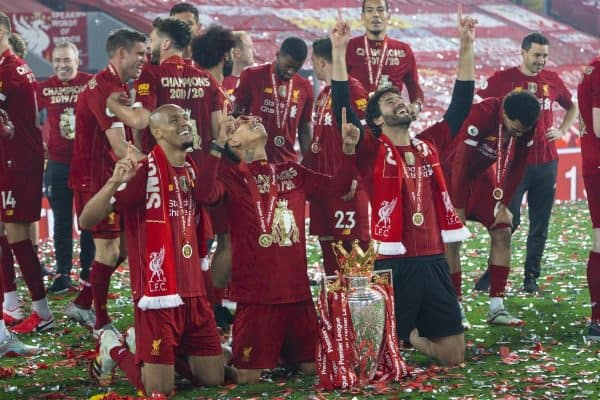 LIVERPOOL, ENGLAND - Wednesday, July 22, 2020: Liverpool's three Brazilians Fabio Henrique Tavares 'Fabinho', Roberto Firmino and goalkeeper Alisson Becker with the Premier League trophy after as their side are crowned Champions after the FA Premier League match between Liverpool FC and Chelsea FC at Anfield. The game was played behind closed doors due to the UK government's social distancing laws during the Coronavirus COVID-19 Pandemic. Liverpool won 5-3. (Pic by David Rawcliffe/Propaganda)